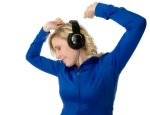Young woman dancing in headphones