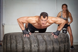 © Tom861 | Dreamstime.com - Push Up On A Tire Crossfit Training Photo